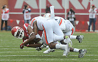 NWA Democrat-Gazette/MICHAEL WOODS • @NWAMICHAELW<br /> University of Arkansas receiver Dominique Reed is tackled by Auburn defenders during Saturdays game October, 24, 2015 against Auburn at Razorback Stadium in Fayetteville.