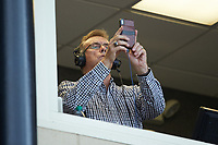 Former Major League Baseball All-Star and current Wake Forest Demon Deacons radio analyst Lary Sorensen uses his smart phone to take a photo during the NCAA baseball game between the Davidson Wildcats and the Wake Forest Demon Deacons at David F. Couch Ballpark on May 7, 2019 in  Winston-Salem, North Carolina. The Demon Deacons defeated the Wildcats 11-8. (Brian Westerholt/Four Seam Images)