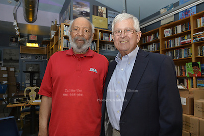 """Jackson, MS. 9/9/2015 Photographer and author Ed Meek sits with civil rights icon James Meredith at Lemuria Books. Meek was the school photographer on the campus of Ole Miss in 1962 during the riots while James Meredith, the first black student enrolled at The University of Mississippi. Meek just released a new book called """"RIOT"""" about his time covering the riot that  ensued while Meredith enrolled on campus on Sept. 30, 1962 and the days that followed.  ©Suzi Altman"""