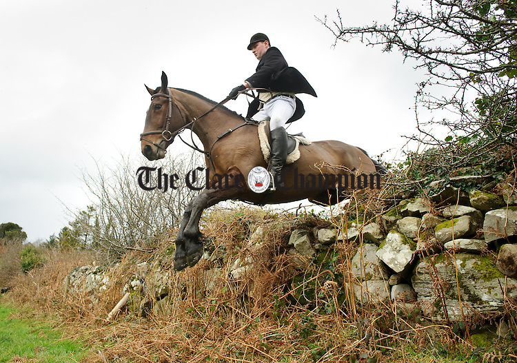Hunt chairman David Jones clears a wall at the East Clare Harriers hunt in Broadford. Photograph by John Kelly.