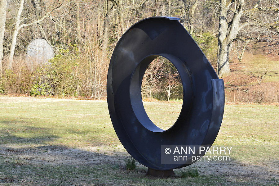 Roslyn, New York, U.S. - April 12, 2014 - During International Slow Art Day, an annual worldwide event celebrating art, visitors view the outdoor sculptures and the Garden Party and the AftermodernisM exhibits at the Nassau County Museum of Art on Long Island.