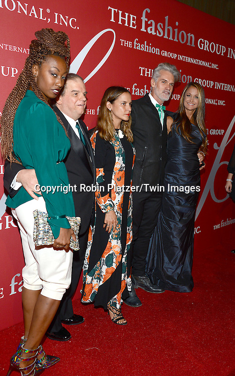 Dominique Drakeford, Harvey       and group attends the 31st Annual Night of Stars &quot;The Protagonists&quot;<br /> presented by The Fashion Grouip International on October 23, 2014 at Cipriani Wall Street in New York City. <br /> <br /> photo by Robin Platzer/Twin Images<br />  <br /> phone number 212-935-0770