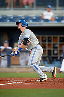 Dunedin Blue Jays catcher Riley Adams (23) hits a grand slam home run in the top of the fourth inning during a game against the Charlotte Stone Crabs on June 5, 2018 at Charlotte Sports Park in Port Charlotte, Florida.  Dunedin defeated Charlotte 9-5.  (Mike Janes/Four Seam Images)