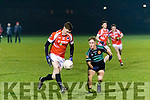 Breandain Savage, St Pat's, solos past Churchill's Gary Rolls when the sides met in the Lee Strand St Brendans Football Board, Senior Championship Final, in Caherslee, Tralee last Saturday night.