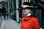 Uniformed doorman outside the Lloyds Building in the City of London.