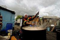 """Preparing """"Umkhomboti"""", the local beer."""