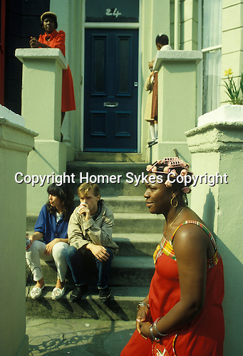 Woman in pink curlers Notting hill Gate West London UK. 1970s.