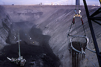 A bucket that can hold 170 cubic yards of material while unearthing rock down to a coal seam.  Arch Coal company employs over 500 workers at Black Thunder, which for many years was the nation's single largest coal mine in Wyoming's Powder River Basin...Black Thunder works coal reserves with five draglines in the 70 foot Wyodak seam producing more than 65 million tons of coal annually on federal land. The low-sulphur, sub-bituminous coal is suitable for power station fuel without any preparation except crushing.  ..Black Thunder produces more than two tons of coal per second, 24 hours a day, 365 days a year. The mine surpassed a 750 million ton shipment milestone 25 years after opening in 1977.