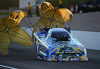 Oct. 27, 2012; Las Vegas, NV, USA: NHRA funny car driver John Force during qualifying for the Big O Tires Nationals at The Strip in Las Vegas. Mandatory Credit: Mark J. Rebilas-
