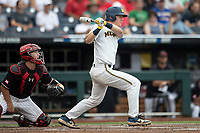 Michigan Wolverines first baseman Jimmy Kerr (15) follows through on his swing during Game 1 of the NCAA College World Series against the Texas Tech Red Raiders on June 15, 2019 at TD Ameritrade Park in Omaha, Nebraska. Michigan defeated Texas Tech 5-3. (Andrew Woolley/Four Seam Images)