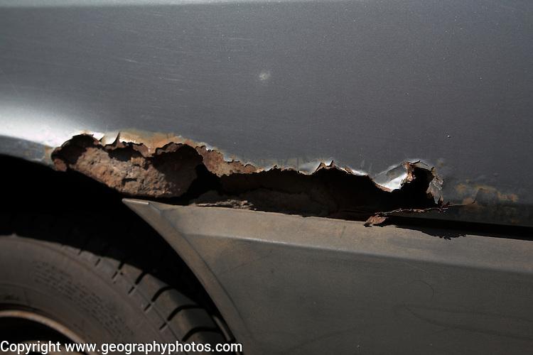 Rust corroding steel of car body