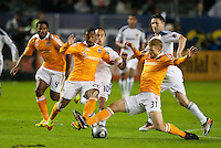 CARSON, CA - November 20, 2011: Houston Dynamo players Corey Ashe (26), Andre Hainault (31) and LA Galaxy midfielder Landon Donovan (10) during the MLS Cup match between LA Galaxy and Houston Dynamo at the Home Depot Center in Carson, California. Final score LA Galaxy 1, Houston Dynamo 0.