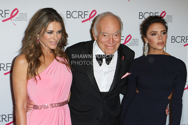 "(L-R) Elizabeth Hurley, Leonard Lauder and Victoria Beckham attend The Breast Cancer Research Foundation ""Super Nova"" Hot Pink Party on May 12, 2017 at the Park Avenue Armory in New York City."