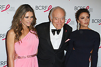 """(L-R) Elizabeth Hurley, Leonard Lauder and Victoria Beckham attend The Breast Cancer Research Foundation """"Super Nova"""" Hot Pink Party on May 12, 2017 at the Park Avenue Armory in New York City."""