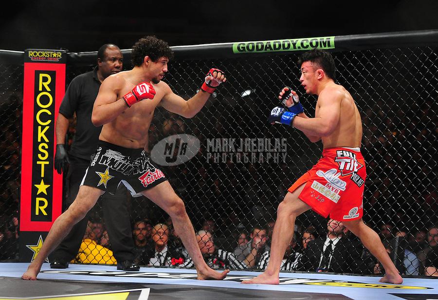 Apr. 9, 2011; San Diego, CA, USA; Strikeforce lightweight world championship fighter Gilbert Melendez (left) against Tatsuya Kawajiri during a bout at the Valley View Casino Center. Mandatory Credit: Mark J. Rebilas-