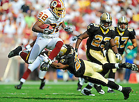 Redskins PR Antwaan Randle El (82) tries to hurdle Saints defender Usama Young (28) on a punt return. The Washington Redskins defeated the New Orleans Saints 29-24 9-14-08 at FedEx Field in Landover, MD.