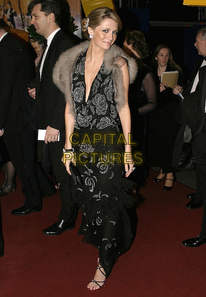MISCHA BARTON.Official BAFTA Aftershow Dinner Party, .Grosvenor House, Park lane, London, .February 12th 2005..full length black patterned dress low cut plunging neckline grey fur shrug wrap collar cape shawl.Ref: AH.www.capitalpictures.com.sales@capitalpictures.com.©Capital Pictures.