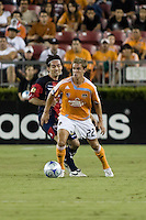 Atlante FC midfielder Gerardo Espinoza (6) attempts to steal the ball from Houston Dynamo midfielder Stuart Holden (22). Houston Dynamo defeated Atlante FC 4-0 during the group stage of the Superliga 2008 tournament at Robertson Stadium in Houston, TX on July 12, 2008.