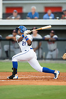 Dennicher Carrasco (21) of the Burlington Royals follows through on his swing against the Danville Braves at Burlington Athletic Stadium on August 12, 2017 in Burlington, North Carolina.  The Braves defeated the Royals 5-3.  (Brian Westerholt/Four Seam Images)