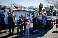 The Roma photographing the arrival of Matteo Salvini to Roma camp.<br /> The secretary of the Northern League, Matteo Salvini visited the roma camp  of Via Salviati to Tor Sapienza neighborhood on the outskirts of Rome.  The Roma camp in via Salviati and inhabited by about 450 people from the former Yugoslavia. Rome, Italy. 24th Febraury 2016.