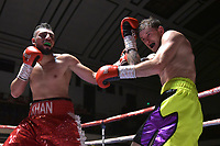 Daniel Khan (red shorts) defeats Dean Jones during a Boxing Show at York Hall on 6th October 2018