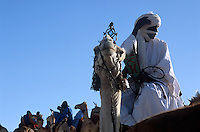 Some 300 Tuareg riders arrive by camel at the Festival au Desert music and culture festival in Essakane, Mali, Friday, Jan. 10, 2008. The riders surrounded the stage area shortly before the start of the festival.
