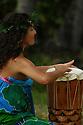 A Hawaiin woman drums on the island of Kauai, Hawaii.  Shot on location with Idanha Films.