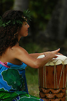 A Hawaiin woman drums on the island of Kauai, Hawaii.  Shot on location with Idanha Films.