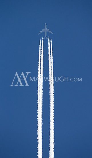 A jet flies over Yellowstone National Park.