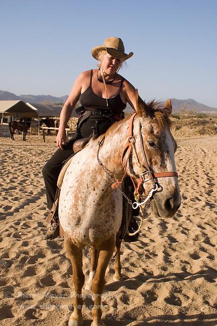 Tourists horseback riding in Cabo San Lucas, Baja California, Mexico