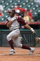 Center fielder Kyle Colligan #12 of the Texas A&M Aggies follows through on his swing versus the UC-Irvine Anteaters in the 2009 Houston College Classic at Minute Maid Park February 27, 2009 in Houston, TX.  The Aggies defeated the Anteaters 9-2. (Photo by Brian Westerholt / Four Seam Images)