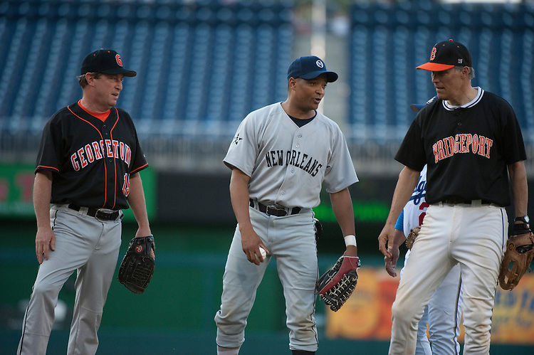 UNITED STATES - JULY 14: Ben Chandler, D-KY., Cedric Richmond, D-LA., and Jay Inslee, D-WA., talk at the mound during the 50th Annual Roll Call Congressional Baseball Game held at Nationals Stadium, July 14, 2011.(Photo By Douglas Graham/Roll Call)