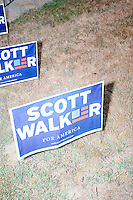 Campaign signs for Republican presidential candidate and governor of Wisconsin Scott Walker stand in the lawn before he speaks at a meet and greet with veterans at the Derry VFW in Derry, New Hampshire.