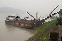 Daytime landscape view of a two docked river freighters on the Cháng Jiāng at the Lizhuang old town port in the Yíbīn county Cuiping District in Sichuan Province.  © LAN