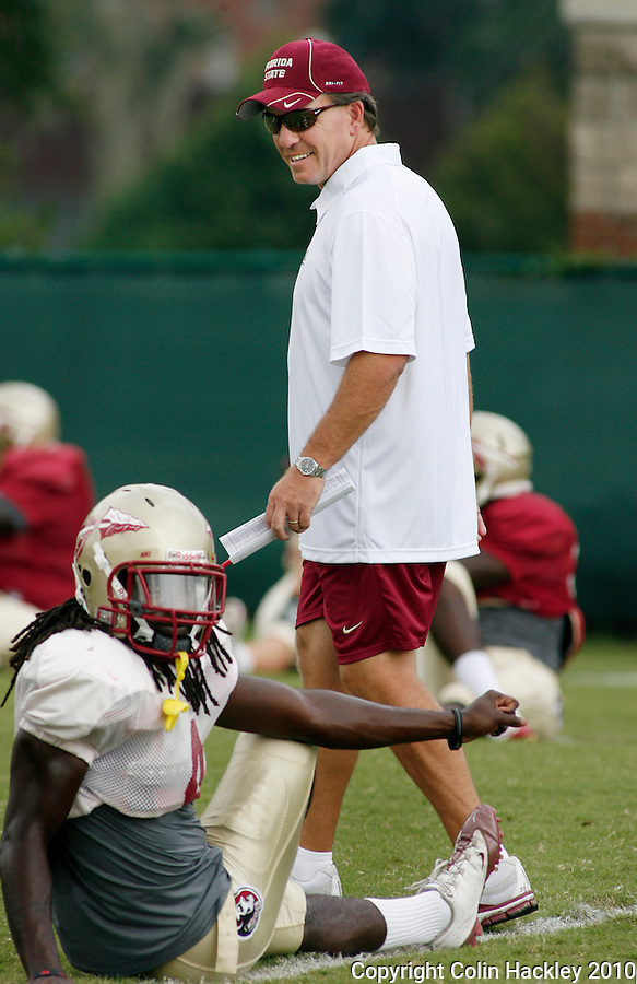 TALLAHASSEE, FL 8/25/10-FSU-082510 CH-Florida State Head Coach Jimbo Fisher walks the field as his team stretches during practice Wednesday in Tallahassee. .COLIN HACKLEY PHOTO