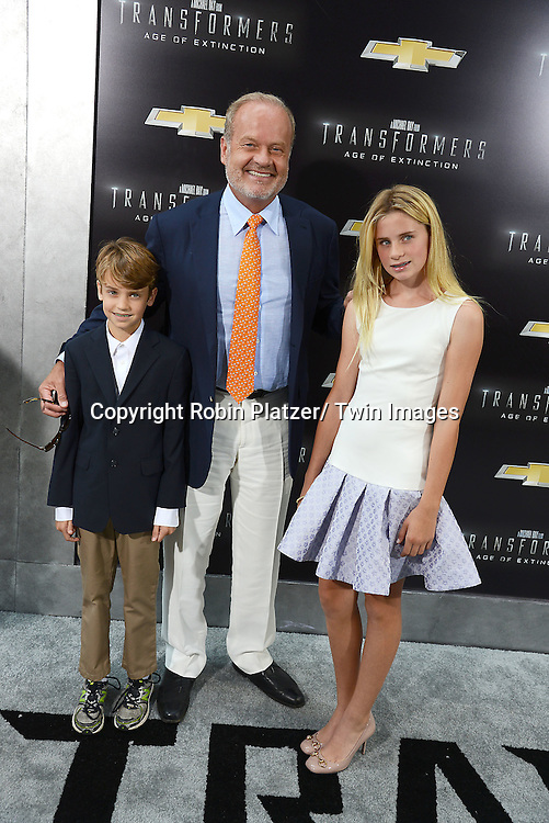 "Kelsey Grammer and children Jude and Mason  attend the US Premiere of ""Transformers: Age of Extinction"" on June 25, 2014 at The Ziegfeld Theatre in New York City, New York, USA."