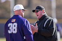 First base umpire Jerry Riddle explains a call to High Point Panthers head coach Craig Cozart (38) during the game against the UNCG Spartans at Willard Stadium on February 14, 2015 in High Point, North Carolina.  The Panthers defeated the Spartans 12-2.  (Brian Westerholt/Four Seam Images)