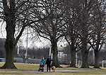 Duane Danforth and his wife Shannon of Boston enjoys the temperatures in the 50's Sunday afternoon,January 28, 2018, as they take their infant daughter Gwen and dog Trigger for a walk at Joe Moakley Park in South Boston. Herald Photo by Jim Michaud