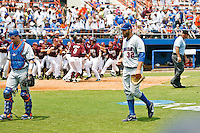 June 11, 2011:   Florida Gators lhp Steven Rodriguez (32) walks off the mound as the Mississippi State Bulldogs celebrate in the background after giving up a 9th inning home run during NCAA Gainesville Super Regional Game 2 action between Florida Gators and Mississippi State Bulldogs played at Alfred A. McKethan Stadium on the campus of Florida University in Gainesville, Florida.   Mississippi State defeated Florida 4-3.........