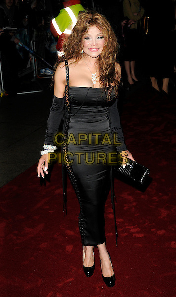"LA TOYA JACKSON .Attending the UK film premiere of ""The Imaginarium Of Doctor Parnassus"" at the Empire Leicester Square cinema, London, England, UK, October 6th 2009..Latoya full length black lace-up sides corset dress platform patent christian louboutin shoes clutch bag silver diamond bracelets sleeves arm warmers cleavage .CAP/CAN.©Can Nguyen/Capital Pictures"