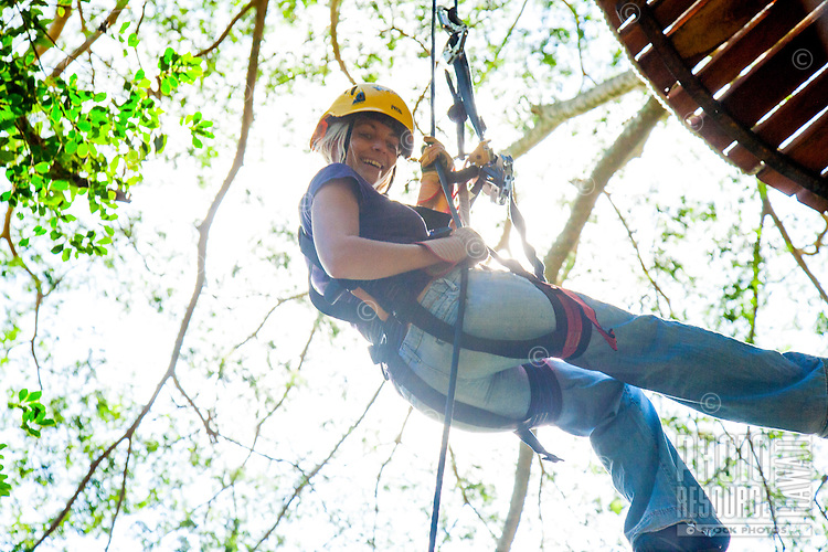 Woman repelling during a Ziplining tour on the Big island with Kohala zipline