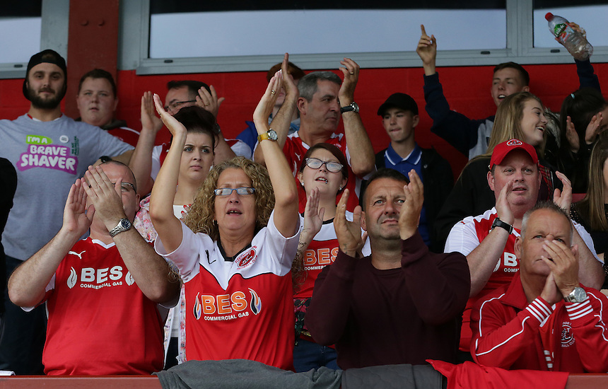 Fleetwood Town fans celebrate their teams 4-0 victory at the final whistle<br /> <br /> Photographer Stephen White/CameraSport<br /> <br /> Football - The Football League Sky Bet League One - Fleetwood Town v Colchester United - Saturday 22nd August 2015 - Highbury Stadium - Fleetwood<br /> <br /> &copy; CameraSport - 43 Linden Ave. Countesthorpe. Leicester. England. LE8 5PG - Tel: +44 (0) 116 277 4147 - admin@camerasport.com - www.camerasport.com