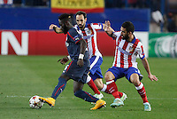 Atletico de Madrid´s Arda Turan (R) and Olympiacos´s Masauku during Champions League soccer match between Atletico de Madrid and Olympiacos at Vicente Calderon stadium in Madrid, Spain. November 26, 2014. (ALTERPHOTOS/Victor Blanco) /NortePhoto