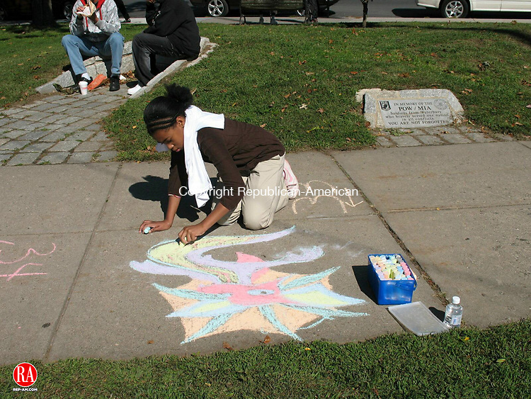 WATERBURY, CT - 05 October 2008 - 100408RA01 - Kayla Wright, 11, a seventh grade student at North End Middle School, puts the finishing touches on the water dragron that she drew on Saturday during the annual Downtown Draw in downtown Waterbury.