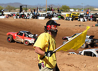 Apr 16, 2011; Surprise, AZ USA; LOORRS flagman official during round 3 at Speedworld Off Road Park. Mandatory Credit: Mark J. Rebilas-