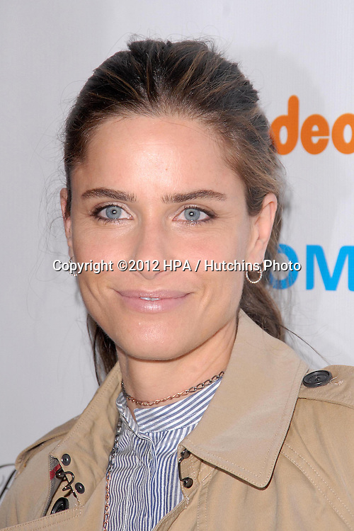 LOS ANGELES - DEC 7:  Amanda Peet arrives to the 2012 March Of Dimes Celebration Of Babies at Beverly Hills Hotel on December 7, 2012 in Beverly Hills, CA