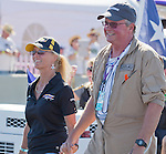 Rare Bear pilot Stewart Dawson, right, walks at the Air Races at the Reno-Stead Airfield on Sunday, Sept. 20, 2015.