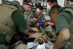 Camp Hit, Hit, IRAQ (April 13, 2005)- Navy Corpsmen operate on Marine Cpl. Michael Lindemuth from 3rd battalion, 25th Marines. During a mortar attack Lindemuth was hit with a piece of shrapnel that entered his chest, went through his lung, and out through his spine. 2D Marine Division, in support of Operation Iraqi Freedom III, is engaged in Security and Stabilization Operation (SASO) in the Al Anbar province in Iraq. (Official U.S. Marine Corps photograph by LCpl. Keller, Shane, S.)