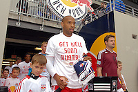 Thierry Henry (14) of the New York Red Bulls and Drew Moor (3) of the Colorado Rapids lead their teams onto the field. The New York Red Bulls defeated the Colorado Rapids 4-1 during a Major League Soccer (MLS) match at Red Bull Arena in Harrison, NJ, on March 25, 2012.