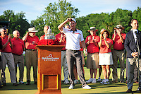 Bethesda, MD - June 29, 2014: Justin Rose at the podium about to receive the Quicken Loan national trophy at Congressional Country Club in Bethesda MD. The win gives Rose a total of six PGA Tour titles. (Photo by Phillip Peters/Media Images International)
